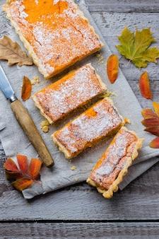 Pumpkin pie, tart made for thanksgiving day. grey stone background.