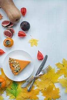 Pumpkin pie. traditional american pie. autumn theme. halloween food. thanksgiving day. light wooden .