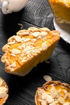 Pumpkin pie with almond slices