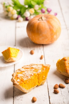 Pumpkin pie with almond slices