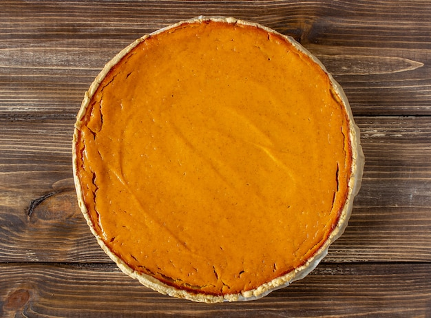Pumpkin pie on a wooden . traditional recipe.