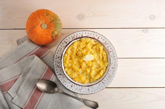 Pumpkin porridge with butter and a pumpkin