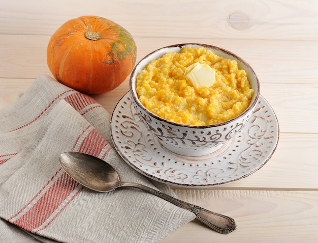 Pumpkin porridge with butter and a pumpkin