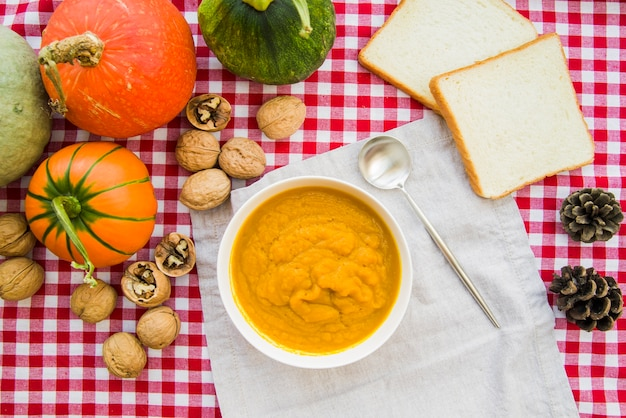 Pumpkin puree in bowl on decorated table