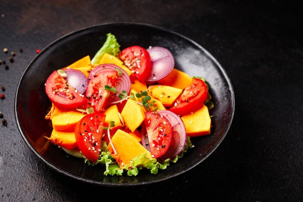 Pumpkin salad vegetables tomato mix fresh meal snack on the table copy space food background rustic
