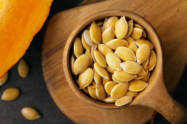 Pumpkin seeds in bowl, raw seed