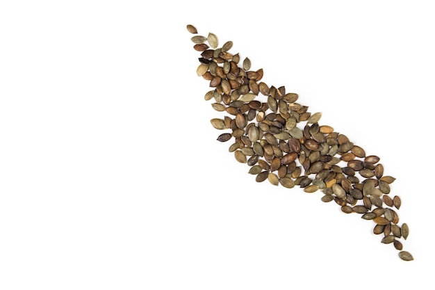 Pumpkin seeds isolated on white.