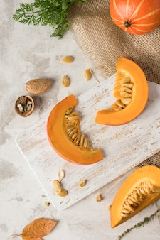 Pumpkin slices on wooden board