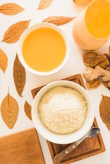 Pumpkin soup and potato puree on table