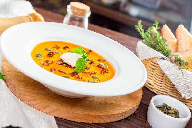 Pumpkin soup in white plate