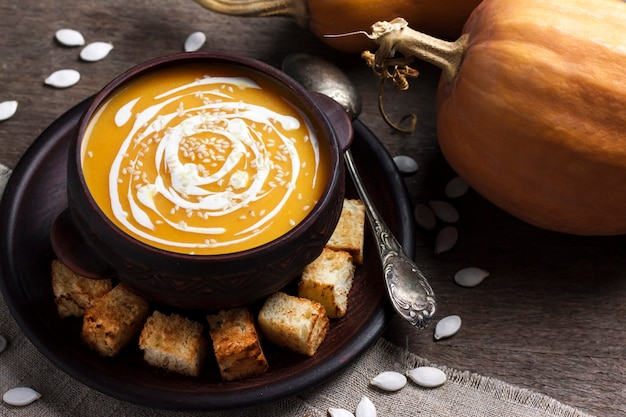 Pumpkin soup with cream and sesame seeds with croutons