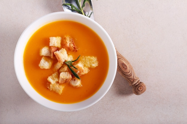 Pumpkin soup with croutons in a bowl