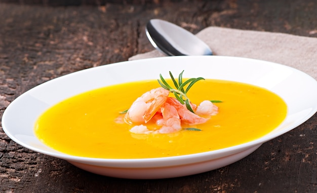 Pumpkin soup with shrimp and rosemary