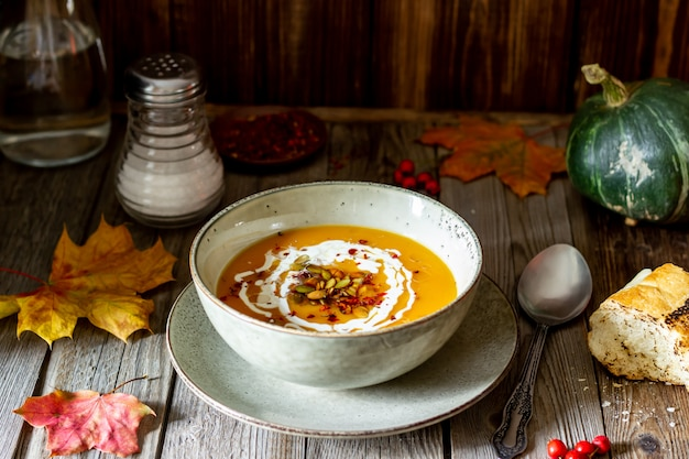Pumpkin soup on a wooden . healthy eating.
