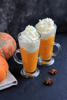 Pumpkin spice latte, smoothie, boozy cocktail with whipped cream on black