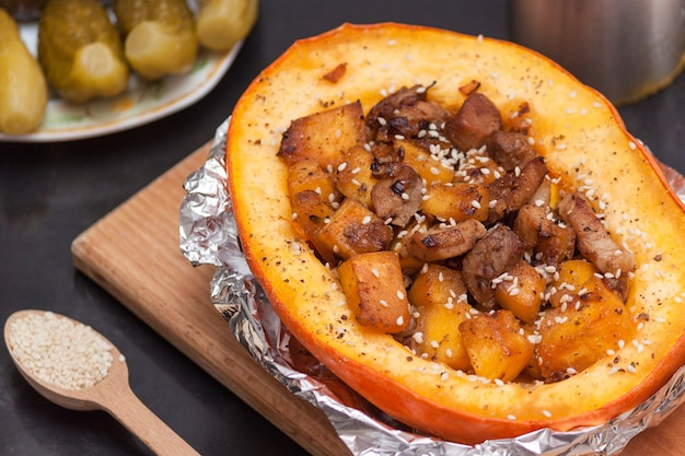 Pumpkin stuffed with meat and vegetables. healthy eat concept.