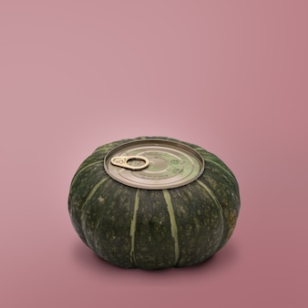 Pumpkin with can lid on pink background