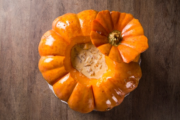 Pumpkin with dried meat (carne seca na moranga) - dried meat with a creamy coconut milk sauce served inside a roasted pumpkin.