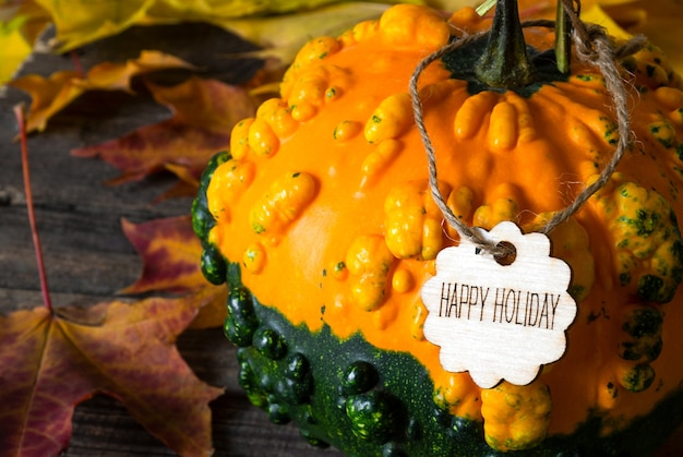 Pumpkin with a happy holiday text. close up