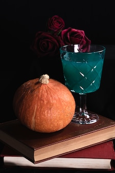 Pumpkin with roses and green drink