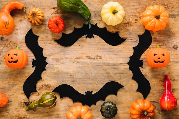 Pumpkins and black paper bats
