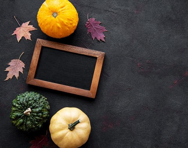 Pumpkins and blackboard on a black background