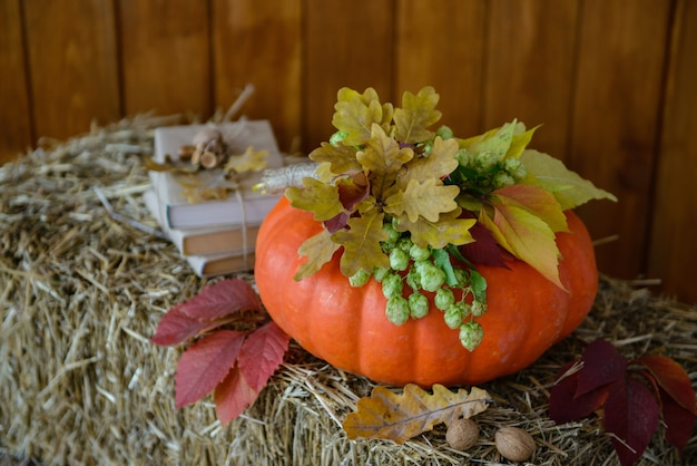 Pumpkins and candles as elements of autumn scenery