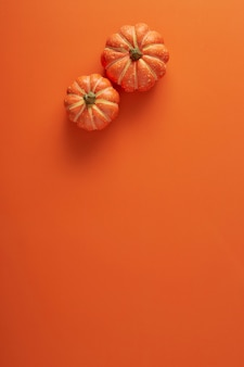 Pumpkins decorations on orange paper