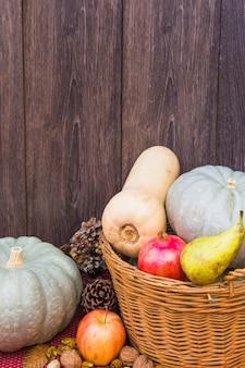 Pumpkins in basket on table