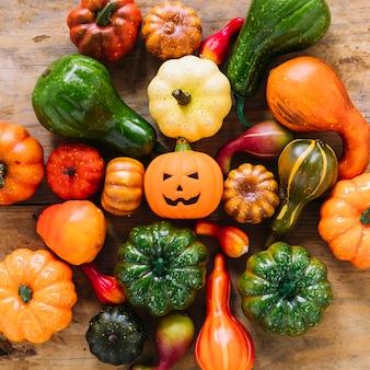 Pumpkins and jack-o-lantern on table