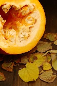 Pumpkins with autumn leaf