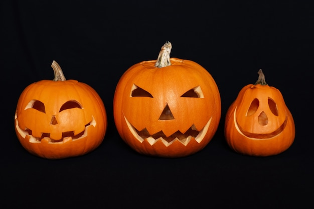 Pumpkins with carved faces for halloween celebration