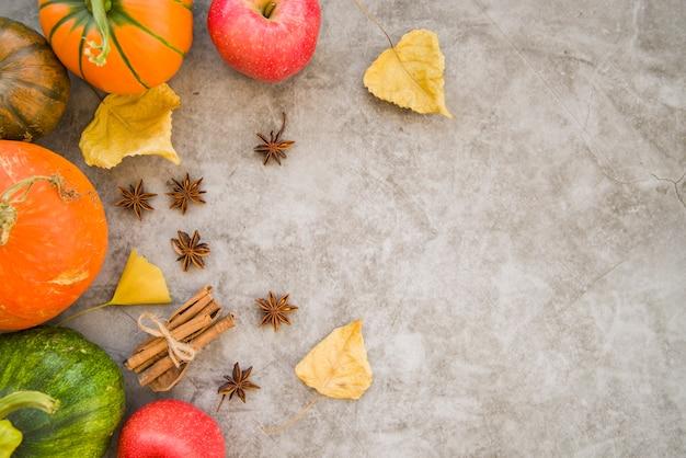 Pumpkins with cinnamon on table