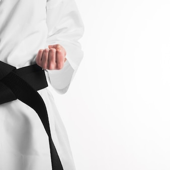 Punch of fighter with black belt