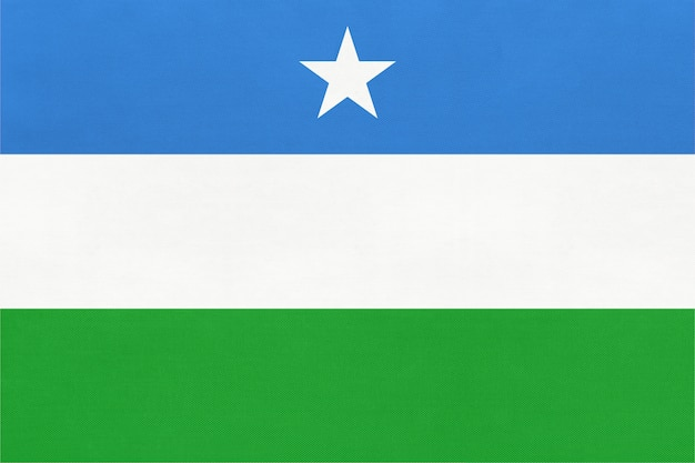 Puntland national fabric flag textile background. symbol of world african country.
