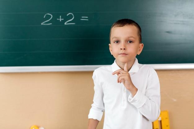 Pupil boy in math class