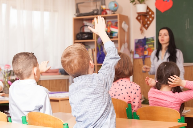 Pupilboys raised his hand in class and want to answer questions
