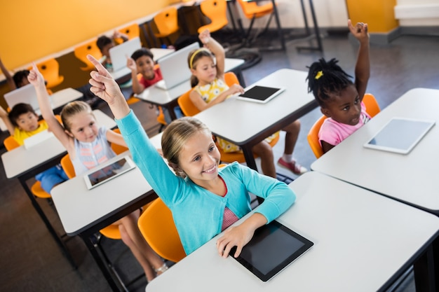 Pupils raising their hands