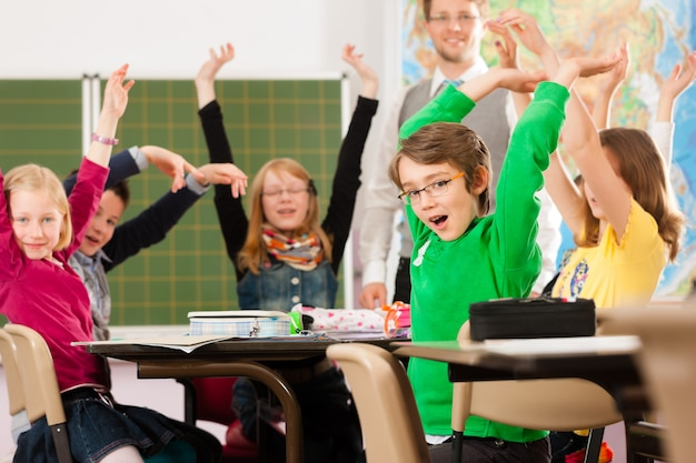 Pupils and teacher learning at school