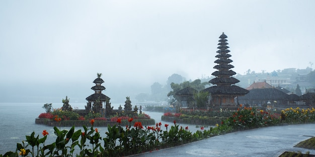 Pura ulun danu bratan. hindu temple surrounded by flowers on bratan lake, bali.