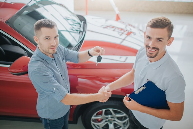 Purchaser and dealer shaking hands
