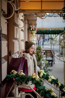 Purchasing of goods and gifts. shopping for family. christmas sale concept. female holding xmas shopping bag gift. big discount.