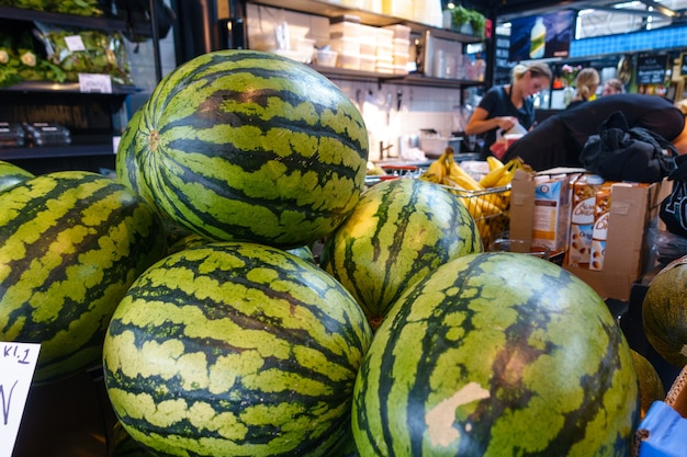 Purchasing watermelons in supermarket