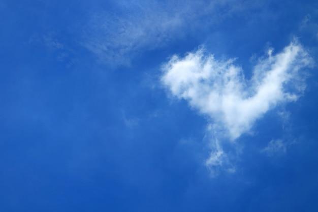 Pure white natural heart shape fluffy cloud on vivid blue tropical sunny sky of bangkok, thailand