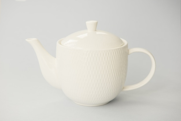 Pure white teapot on grey