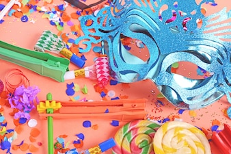 Purim background with carnival mask and party costume
