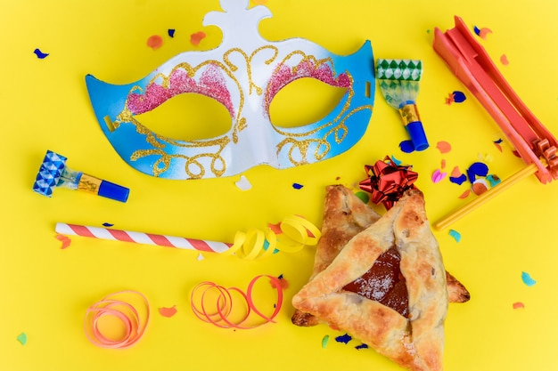 Purim with carnival mask, party costume