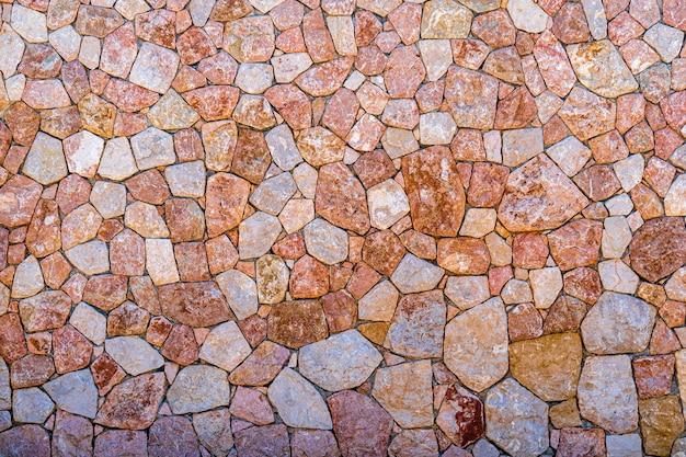 紫とピンクの大理石の石の壁のテクスチャクローズアップ表面グランジ石細工ロック古いパターン