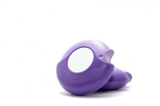 Purple asthma inhalers on white background