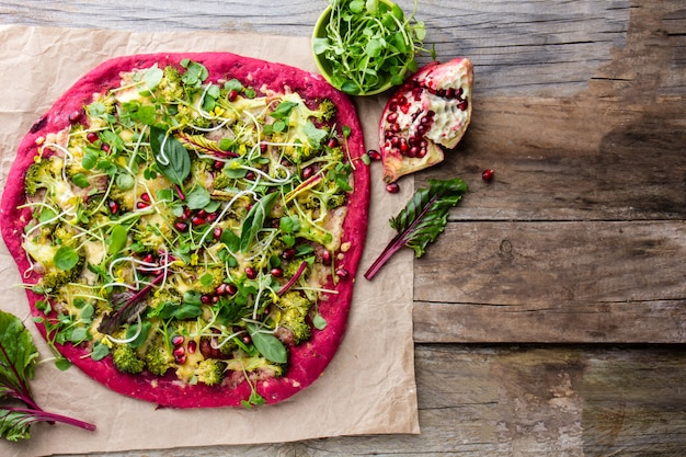 Purple beetroot dough, vegetables and sprouis pizza